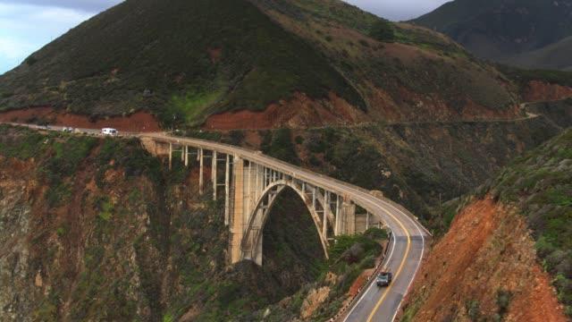 drone shot revealing bixby creek bridge - bixby creek bridge stock videos & royalty-free footage