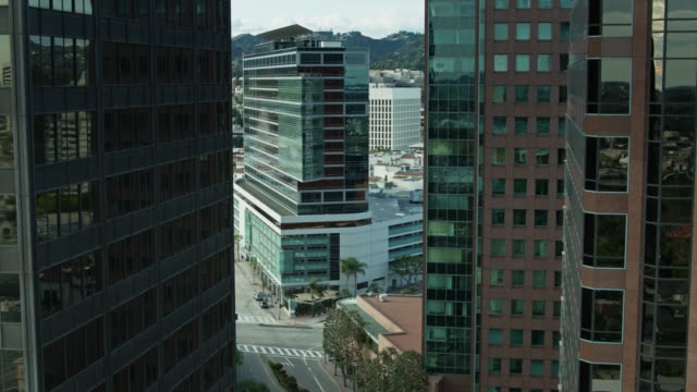 drone shot revealing westwood blvd, los angeles between condo towers - westwood neighborhood los angeles stock videos & royalty-free footage
