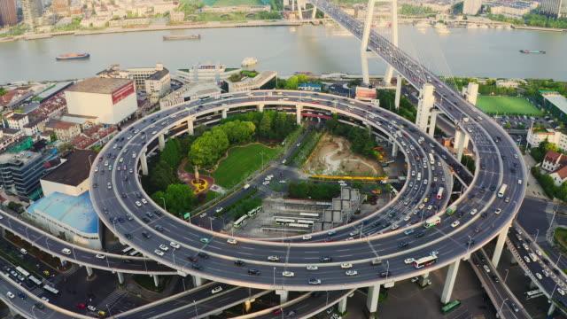 drone shot: rt 4k aerial view of nanpu bridge at dusk, shanghai,china. - direction stock videos & royalty-free footage