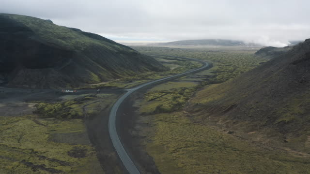 drone shot showing a remote icelandic scene, iceland - rock strata stock videos & royalty-free footage