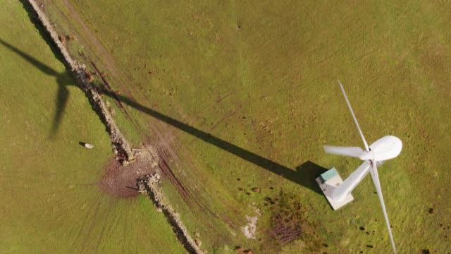 Drone Shot Tilting Upside Town Over Wind Turbine in Lancashire Farmland