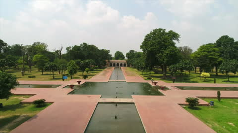 drone shot tracking over islamic garden in pakistan - zoom in stock videos & royalty-free footage