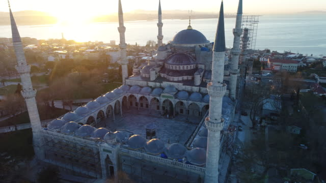 drone shots of istanbul hagia sophia museum and blue mosque at sunrise - dome stock videos & royalty-free footage