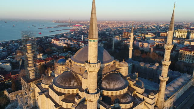 drone shots of istanbul hagia sophia museum and blue mosque at sunrise - sufism stock videos & royalty-free footage