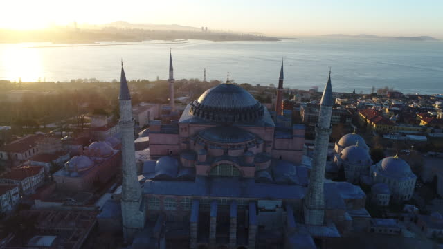 drone shots of istanbul hagia sophia museum and blue mosque at sunrise - mosque stock videos & royalty-free footage