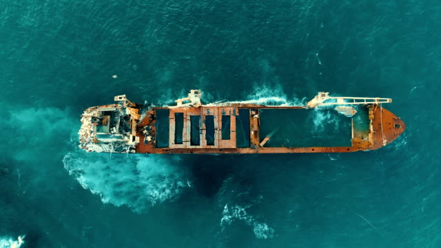 drone shots of sinking ship, stranded ship, old rusty ship, burnt ship, abandoned ship, shipwreck - sink stock videos and b-roll footage