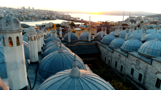 drone shots of suleymaniye madressa's domes and galata bridge on golden horn istanbul at sunrise - madressa stock videos and b-roll footage