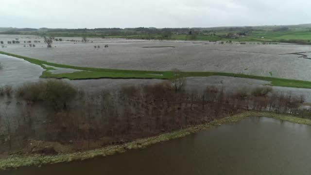 drone shots of the river ouse at cawood near selby in britain which has flooded hundreds of acres of farm land - river ouse stock videos & royalty-free footage
