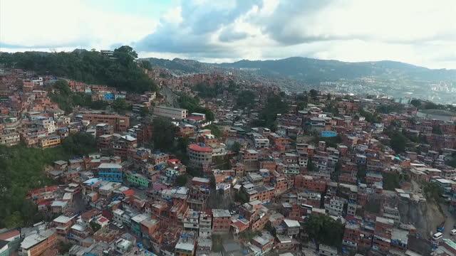 drone shots over a barrio neighbourhood on may 25, 2016 in caracas, venezuela. - caracas stock videos & royalty-free footage