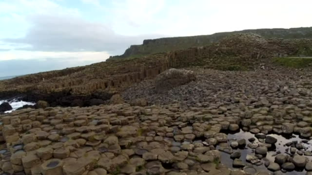 drone shots over the giant's causeway - column stock videos & royalty-free footage