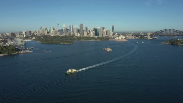drone shots taken of empty ferries on a empty sydney harbour. rare to see the harbour so quiet. the ferries have kept their timetables to ensure some... - ferry stock videos & royalty-free footage