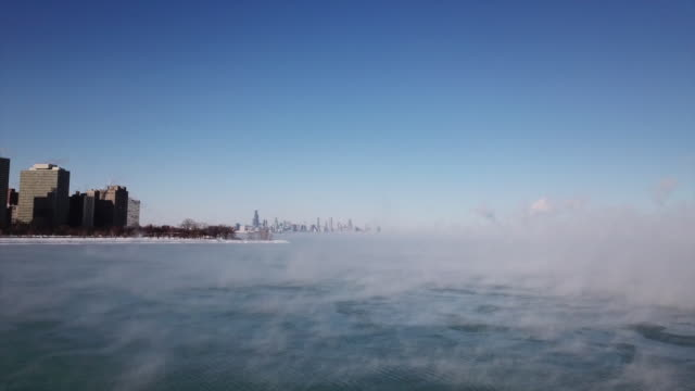 wgn drone pov steaming lake michigan chicago skyline on january 30 2019 - lago michigan video stock e b–roll