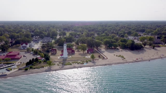 a drone sweeping view of the blue water bridge, st. claire river, sarnia, ontario and port huron - nautical vessel stock videos & royalty-free footage