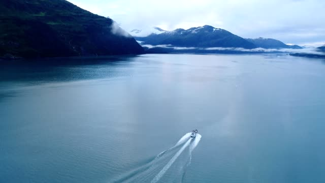 a drone tails a boat in prince william sound whittier alaska - prince william stock videos & royalty-free footage