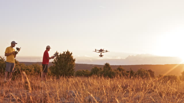 ds drone taking off into the air at sunset - film crew stock videos & royalty-free footage