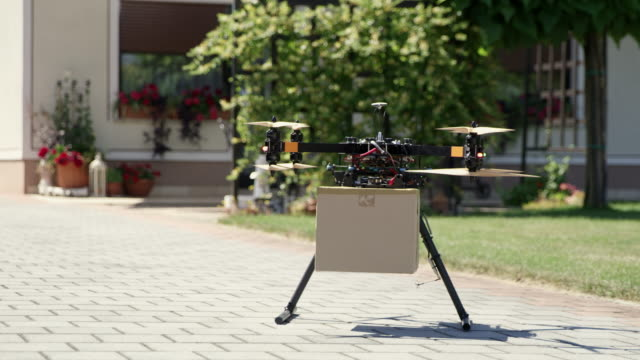 ws drone taking off with a package - driverless transport stock videos & royalty-free footage