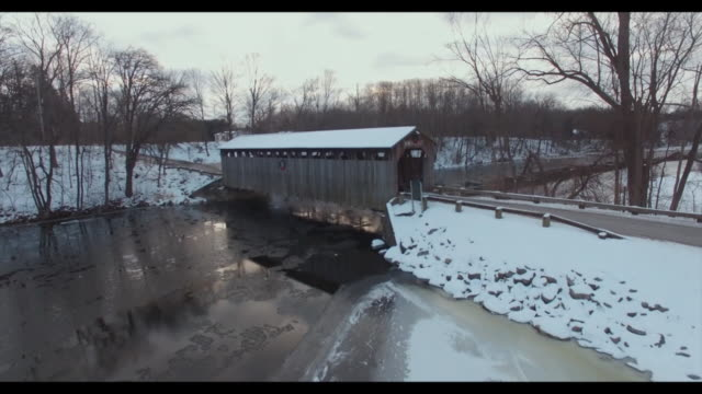 drone the fallasburg bridge, a 100-foot span brown truss covered bridge that was erected in 1871 in vergennes township, michigan, 5 miles north of... - wood material stock videos & royalty-free footage