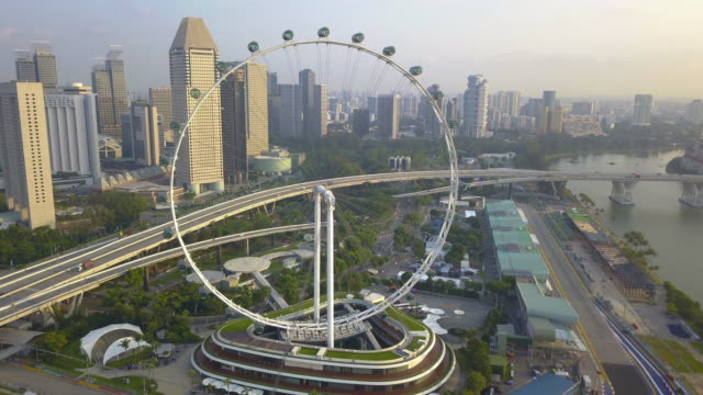 drone time lapse aerial view of singapore flyer in the morning, singapore - singapore flyer stock videos and b-roll footage