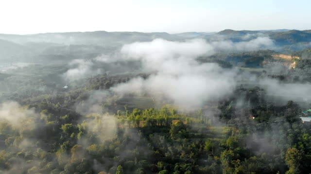 Drone time lapse, Flying Above foggy Landscape.