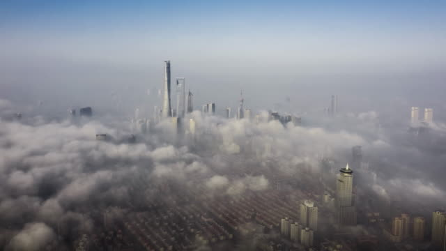 drone time lapse : Shanghai Financial District In Fog