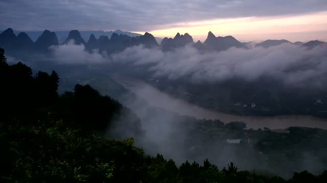 drone time lapse video of clouds over the lijiang river in guilin, south china's guangxi zhuang autonomous region. footage by: costfoto / barcroft... - digital composite stock videos & royalty-free footage