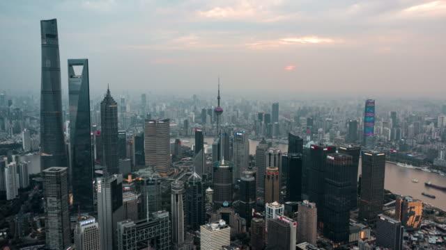 4k drone timelapse footage : shanghai skyline at sunset - lujiazui stock videos & royalty-free footage