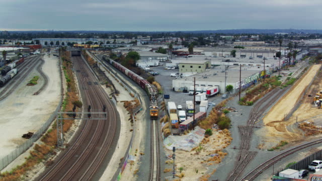 drone tracking shot of freight train on the alameda corridor, los angeles - rail freight stock videos and b-roll footage