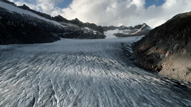 drone tracking shot showing the rhone glacier, switzerland - melting stock videos & royalty-free footage