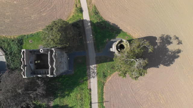drone pov of two medieval towers in ireland - video stock videos & royalty-free footage