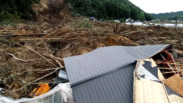 drone video footage taken on sept 9 shows the extent of damage in the town of atsuma southwestern hokkaido where landslides were triggered by a... - ダメージ点の映像素材/bロール