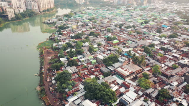 4k drone video of a crowed residential district in dhaka, bangladesh - dhaka stock videos & royalty-free footage