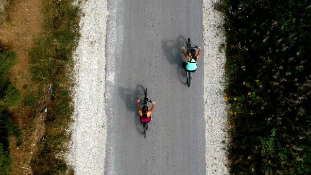 drone video of bicycle riding - sister stock videos & royalty-free footage