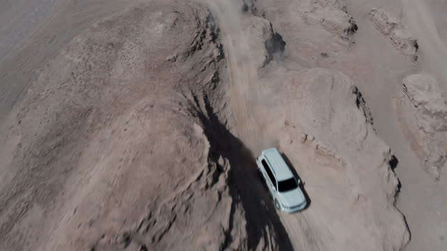 drone video of driving in great yardang landform - china east asia stock videos & royalty-free footage