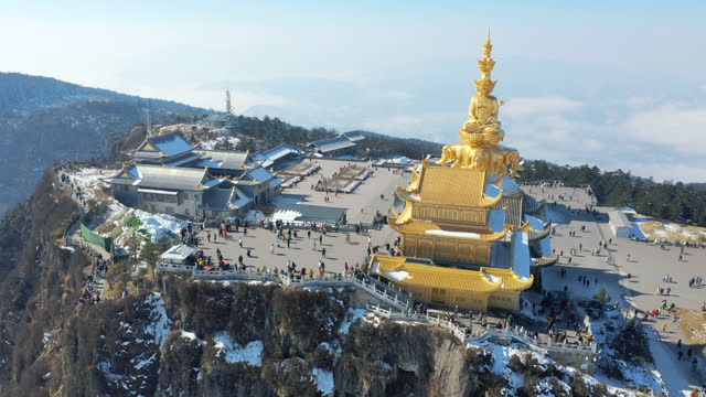drone video of golden statue at mt emei gold summit - temple building stock videos & royalty-free footage