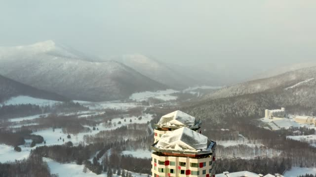 drone video of hoshino resorts tomamu, hokkaido, japan - ski slope stock videos & royalty-free footage