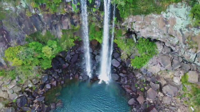 drone video of jeongbang falls in jeju island, south korea - emperor stock videos and b-roll footage