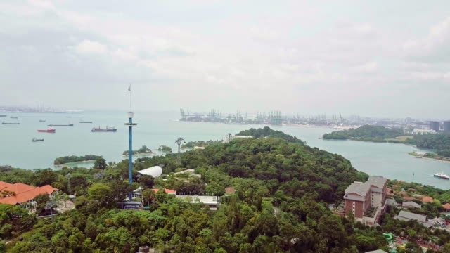 drone video of sentosa island in singapore - merlion fictional character stock videos and b-roll footage