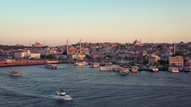 drone video of the bosporus strait and istanbul cityscape - モスク点の映像素材/bロール