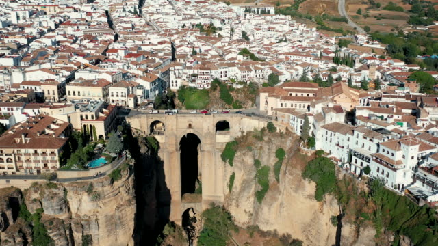 drone video of the cityscape of ronda on the cliff - puente stock videos & royalty-free footage