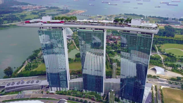 drone video of the downtown area of singapore - marina bay sands stock videos and b-roll footage