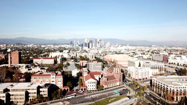 4K drone video of the downtown Los Angeles skyline and its surrounding houses and buildings