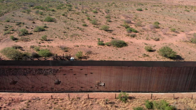 4k drone video of the international wall between mexico and the united states in new mexico where the wall is under construction. - surrounding wall stock videos & royalty-free footage
