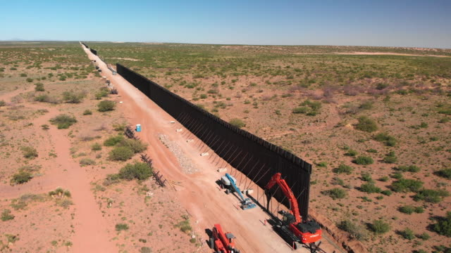4k drone video of the international wall between mexico and the united states in new mexico where the wall is under construction. - wall building feature stock videos & royalty-free footage