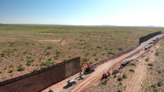 4k drone video of the international wall between mexico and the united states in new mexico where the wall is under construction. - international border barrier stock videos & royalty-free footage