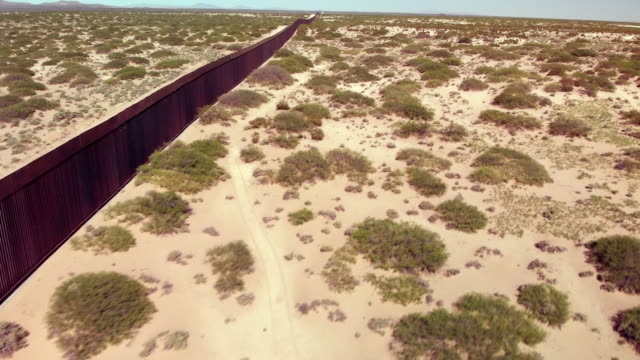 4k drone video of the international wall between mexico and the united states in new mexico where the wall is under construction. - american culture stock videos & royalty-free footage