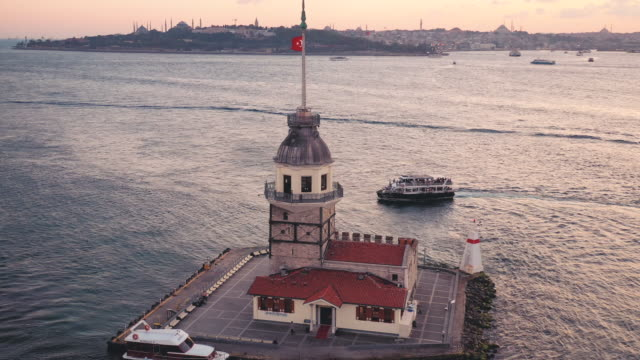 drone video of the maiden's tower in the sunset glow - istanbul stock videos & royalty-free footage