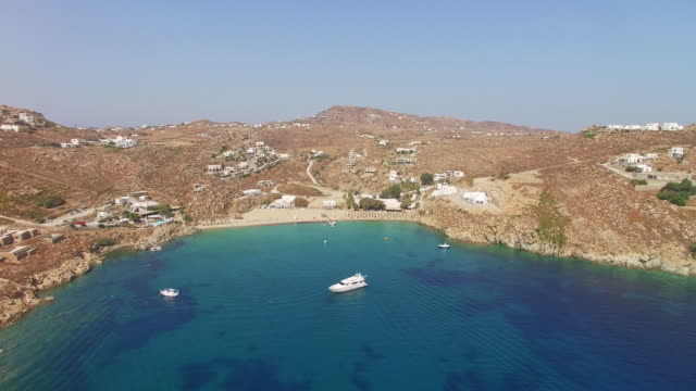 drone video of the paradise beach in mykonos, greece - mykonos stock videos & royalty-free footage