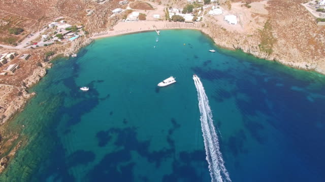 drone video of the paradise beach in mykonos, greece - mykonos stock videos and b-roll footage