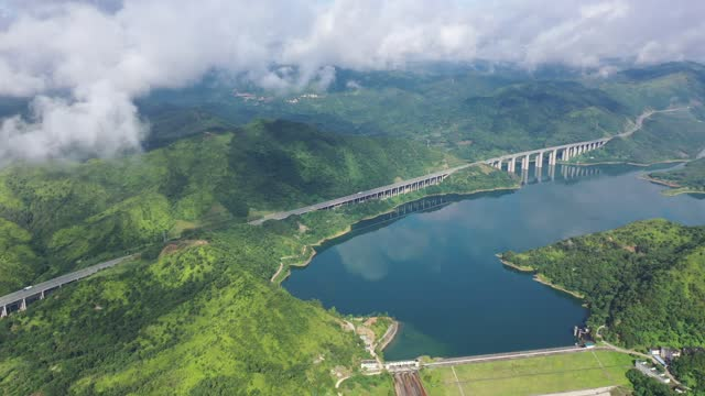 drone video of the shanzhou-zhanjiang expressway in hengjiang reservoir in guangdong province. - reservoir stock videos & royalty-free footage