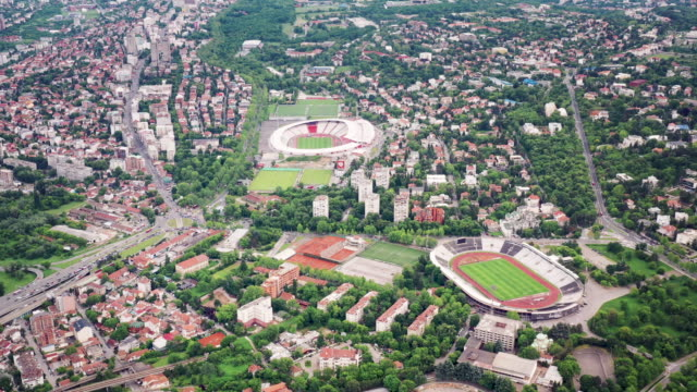 vídeos de stock, filmes e b-roll de drone video of the sport stadiums in belgrade, serbia - sérvia